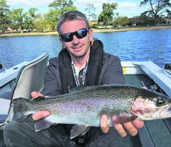Trev Crawford nailing a lovely Lake Wendouree Rainbow trout flyfishing.