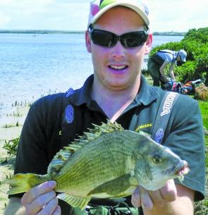 "Daniel Duggan with his extremely unusual capture of a 36cm bream at McLaughlin's beach. He caught it on a 3"" plastic."