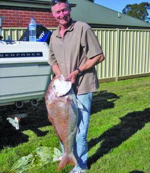 Steve Leatham holds up this whopping big snapper. It weighed 24lbs in the old scale and was one of three massive snapper they caught during a hot bite.