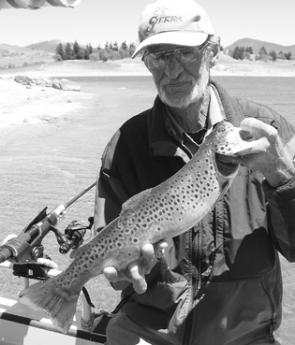 Rick Taylor with a brown trout caught on a mudeye – the prime summer bait for Jindabyne trout.