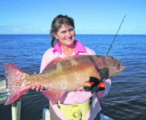 Wendy Marks was very happy landing her PB coral trout on a recent trip off Townsville.