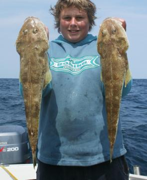 Brandon Cole took this pair of big sand flathead on squid baits fished in 40m of water.