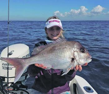 Tayla Egan with a great eating size snapper off Ballina.