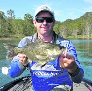 This average sized bass came from the weed edges of Maroon Dam. Check out the southern banks concentrating on features like points and bays.