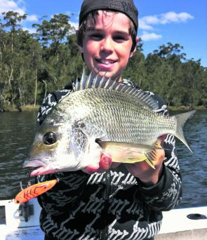 Young Tom 'Moose' Hemphill was stoked after luring his first bream off the surface.