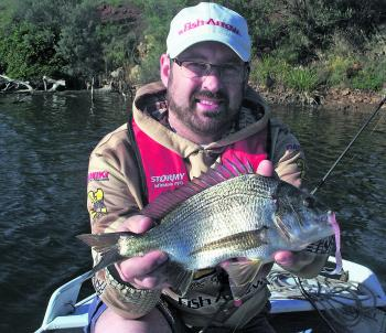 Craig Matthews with a typical Hopkins bream taken on a Damiki 4'' Ripper soft plastic.
