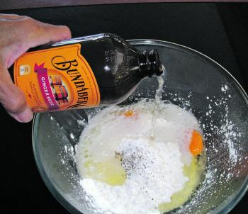Pour the ginger beer into the bowl. I usually pour about three quarters of a bottle (250ml) into the bowl, but you can add the remainder to change the consistency of the batter.
