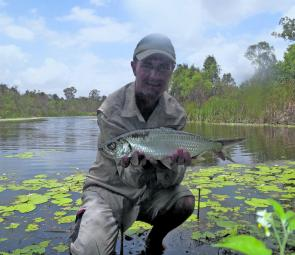 Peter Weir with a tarpon caught in a local waterhole.
