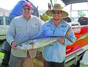 Yamaha outboard national sales and marketing manager Brett Hampson, left, of Brisbane, got plenty of thrills (and barbecue steaks) from this longtail tuna he trolled up on light tackle about 400m from the Evans River bar. Jesse Mayberry, of Mt Cotton, pro