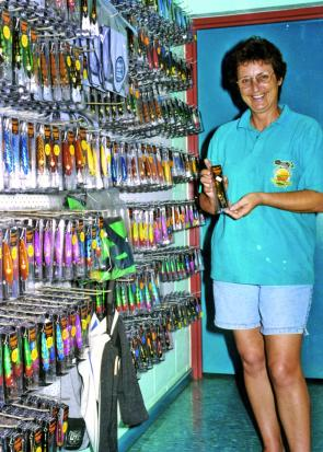 Cheryl Reid with just some of the Reidy's Lures range in the Northern Territory factory and tourist attraction.