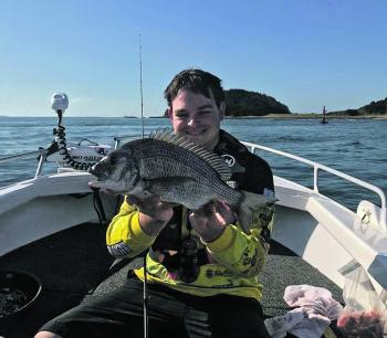 Chris Neville with a couple of bream from the lower Crookhaven River caught on live nippers.