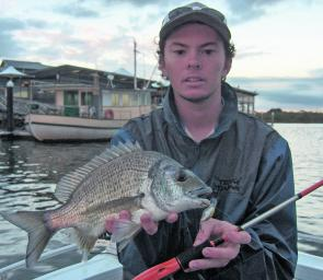 Joe Urquhart with a decent bream caught by working a small diving crankbait around the training walls.