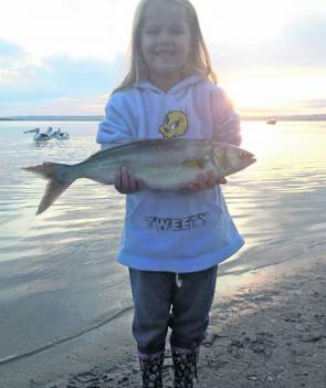 Five year old Cierra Starrett looks happy with her salmon caught at Shallow Inlet with her parents.