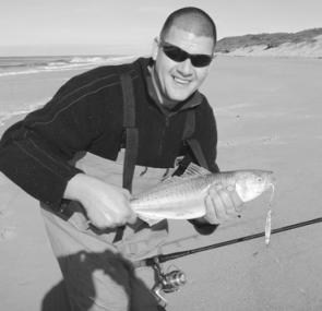 Allways Angling customer Brian with a salmon taken from Golden Beach on a Lazer lure.