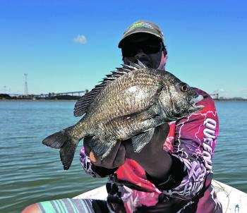 Craig Robertson showing a large pikey bream.