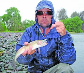 The author with a nice rainbow trout caught in the Tumut River on an IMA Sukari lure. When not in flood, the Tumut River has fished quite well all season and will only get better this month.