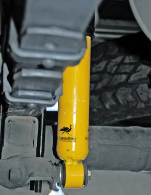 The distinctive yellow OME shock absorbers with the running emu logo are an indication of ride quality.