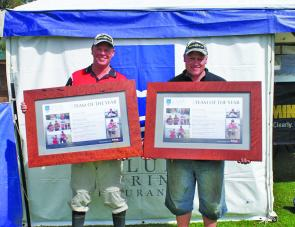 Team Minn Kota's Warren Carter and Cameron Whittam display their 2011 Club Marine Team Of the Year trophies to the crowd.