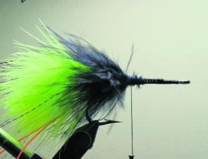 Now take several small bunches of black marabou and tie in on top, underneath and either side of the hook shank.
