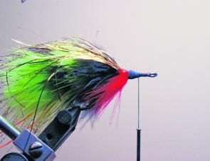 Rotate the hook in the vice and tie in a bunch of bright red marabou as a throat hackle