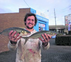 Matt Luscombe shows off a couple of Australian salmon caught at Gunnamatta.