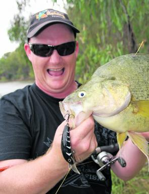Adam Royter, who came second in the Australian Casting Titles shows he is more than just a fancy caster with this cracking golden perch taken on a StumpJumper from the bank.