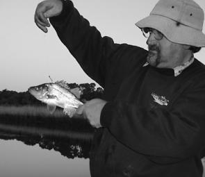 Graham Gray holds up the foul hooked perch taken by the author in the Tarwin River.