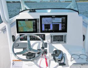Simrad City! Not one but two big units dominate the Sea Fox 286 Commander's dash area. Note, also that only 1 control lever has been programmed to control both engines.