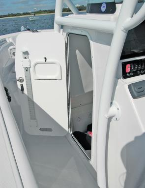 A wide door to port allowed access to the craft's marine toilet within its massive compartment.