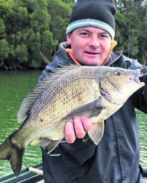 Shane Lowery with a big winter bream. Look upstream for these fish and don't be afraid to use hardbodied lures, even in dirty water.
