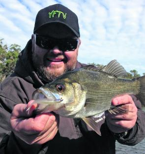 Brendan Wing with great estuary perch, a fish that tends to snaffle lures more frequently than baits in the Gleneleg.