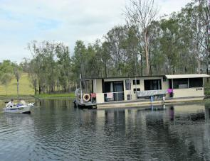 The Lake's houseboat can sleep 10 and is great for being right up the dam in search of fish.