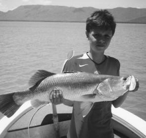 The author's grandson, Kale May, with a 75cm personal best barra.
