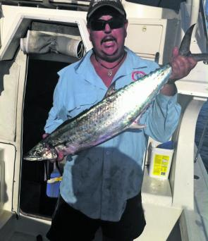 Garry Ferrington with a sized school mackerel from just outside the islands.