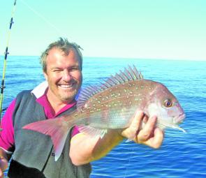 Simon Norris with one of the snapper that are so plentiful on the inshore reefs.