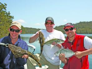 Mike, Dave and Stuie with just part of the catch from a morning on the water.