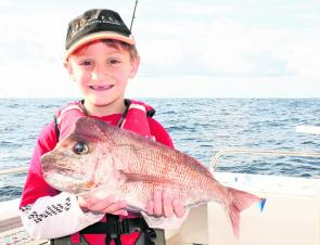 The smile says it all – a good snapper and a very happy young fellow.