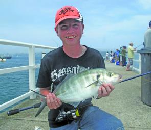Sean with a silver trevally caught on 4lb braid from a wharf.