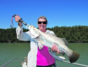 Tracey with her first legal barramundi that went 67cm.