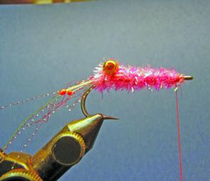 Wind on the chenille taking extra turns in front and immediately behind the dumbbell eyes, then taper towards the hook eye.