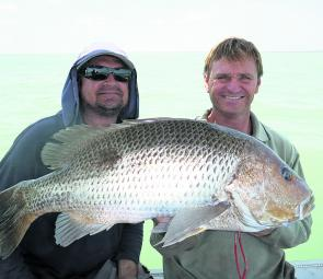 Glenn and Scotty with a solid golden snapper caught wide from Weipa.