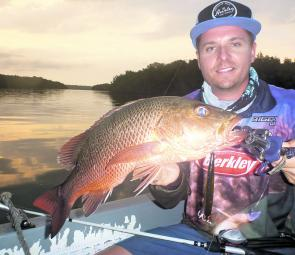 Clint with a stunning mangrove jack pulled from the snags.