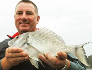 Steve Brooks holding up a typical Hawkesbury bream.