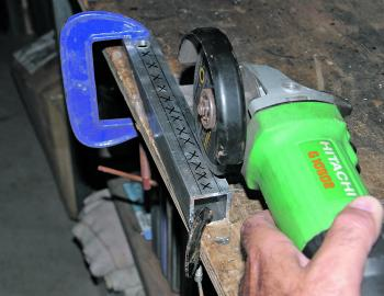 Use a G-clamp or two to secure the aluminium to the bench. I used a Flexovit 100x1.0x16.0mm Ultra-Fast Cut Reinforced Cut-Off Wheel, which was less than $2 at Bunnings. Ensure the blade is securely in your grinder and don a pair of safety glasses. Start y