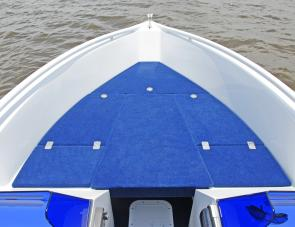 The forward casting deck and bow rider area is covered with plush carpet.
