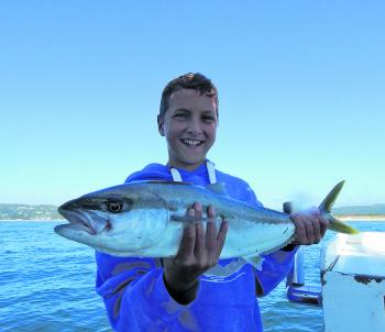 The smile says it all. Rat kingfish are a great species for the kids.