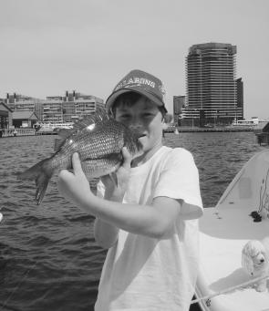 Dougie Bauer with a bream he caught on a lure in the Yarra River on Australia Day.