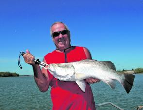 Trolling small lures over the shallow rock bars should result in a decent barramundi.
