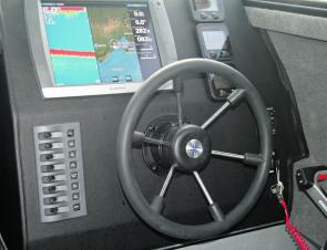 The uncluttered control area contains a flush mounted Garmin sounder GPS system.