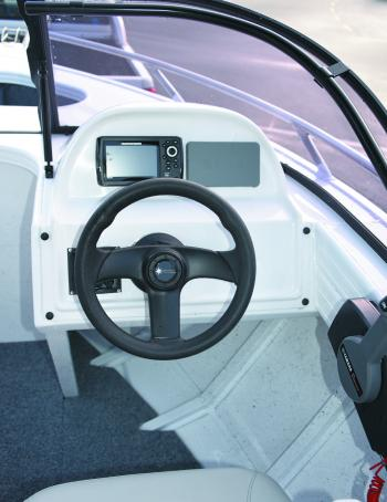 The helm is simple – here it holds the Yamaha LCD gauge and a small fishfinder. The test boat was fitted with mechanical (rather than hydraulic) steering.